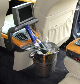 Wedding beige car interior, with champagne and entertainment system.